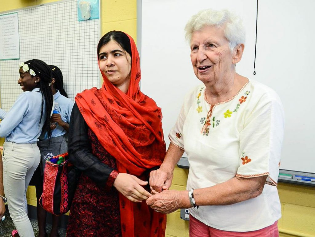"""Nobel Peace Prize winner Malala Yousafzai made a surprise visit to Sophia Academy in 2016. After she was nearly killed by the Taliban in 2012, Sophia students wrote her letters of support. """"I was moved by Malala and all she had done by age 19,"""" Sister Mary muses. """"I was cloistered in a convent at that age."""" (Sophia Academy photo)"""
